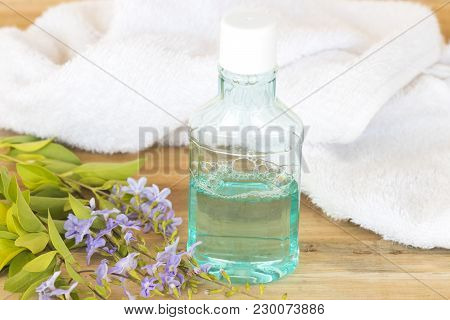 Mouthwash With Bath Tower For Healthy Care Oral Cavity On Background Wooden