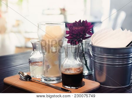 Black Iced Coffee Latte Serve With Frozen Milk And Glass Of Liquid Sugar On Cafe. Coffee Latte Were