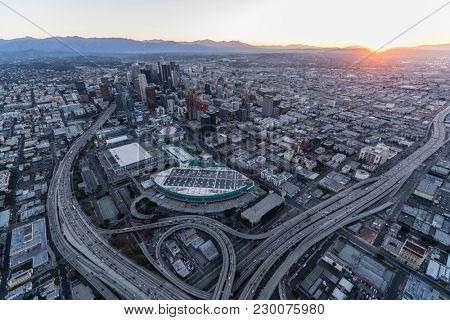 Los Angeles, California, USA - February 20, 2018:  Aerial view of the Santa Monica 10 and Harbor 110 freeway interchange at sunrise in downtown LA.