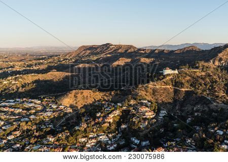 Los Angeles, California, USA - February 20, 2018:  Morning aerial view of the hillside homes with Griffith Park and Hollywood Sign in background.