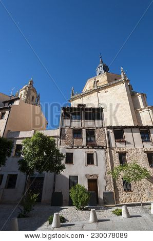 Segovia - May 16, 2015: Traditional Architecture In The Historic Centre Of Segovia, With The Cathedr