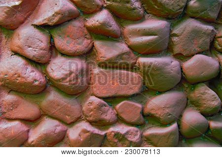 Rock Wall With Large Rounded Stones. Stone Wall Painted With Brown Paint. Stone Background From The