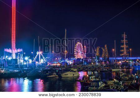 Marina At Night - Yachts And Sailing Ship Mir Moored At  Wharf Of The Marina In Szczecin