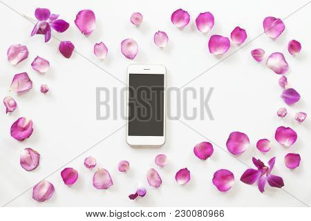 Pink Rose Petals Frame With Smart Phone On White Background. Top View.