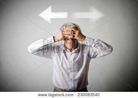 Old Man In White Has To Decide Between Two Directions. Old Man Is Full Of Doubts And Hesitation.