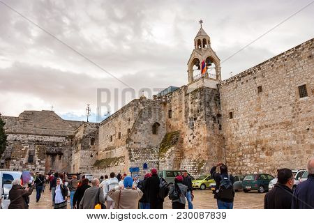 Bethlehem, Israel - November 2011: Groups Of People Gather Outside The Church Of Nativity On Cloudy