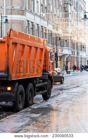 Municipal Cleaning Service Workers Remove Waste With A Garbage Truck