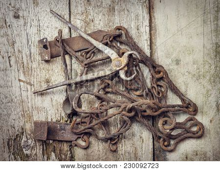 Old Vintage Rusty Tools On A Wooden Surface