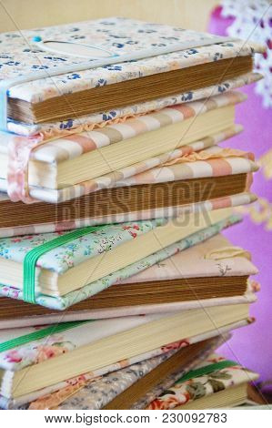 A Stack Of Handmade Notepads Against The Background Of The Handmader Workplace