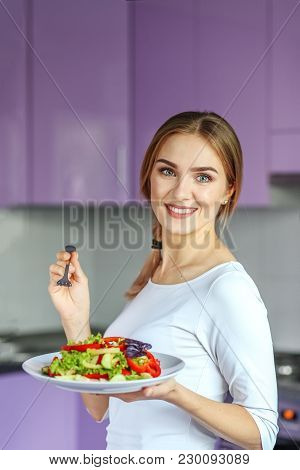 Smiling Young Girl Eating Vegetable Salad.the Concept Is Healthy Food, Diet, Vegetarianism, Weight L