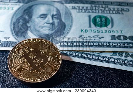 Bitcoin (new Virtual Money) And Banknotes Of One Dollar. Exchange Bitcoin For A Dollar. Conceptual I