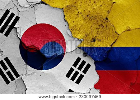 Flag Of South Korea And Colombia Painted On Cracked Wall