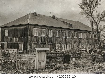 Old Apartment Building. Wooden House. Residential Building. Retro Effect. Old Architecture. Vintage