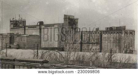 Old Brick Elevator In The City Of Ust-kamenogorsk. Old Architecture. Vintage Style. Retro Effect. Gr