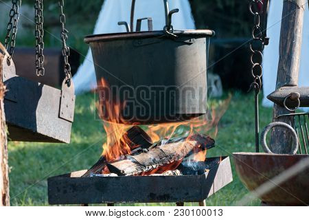 Black Cauldron On Bonfire In Camping In Summer Time