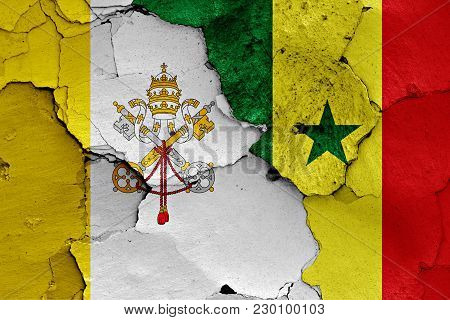 Flag Of Vatican And Senegal Painted On Cracked Wall