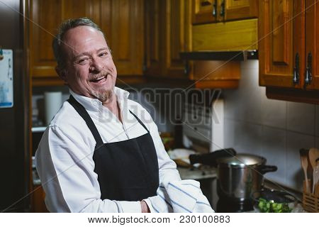 Man Of 59 Year Old Working In The Kitchen Of His House.