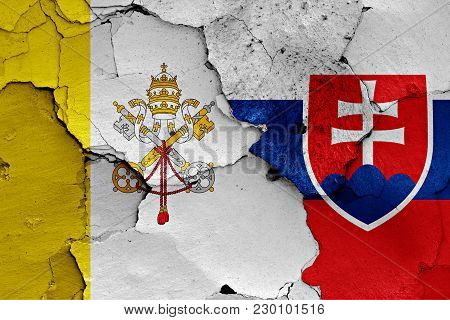 Flag Of Vatican And Slovakia Painted On Cracked Wall