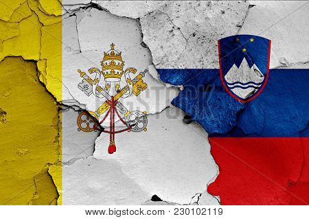 Flag Of Vatican And Slovenia Painted On Cracked Wall