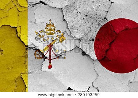 Flag Of Vatican And Japan Painted On Cracked Wall