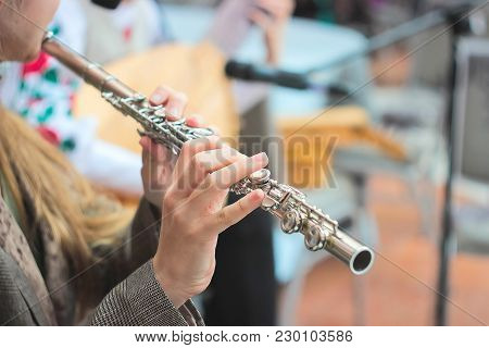 Hands Of Young Girl Playing A Flute