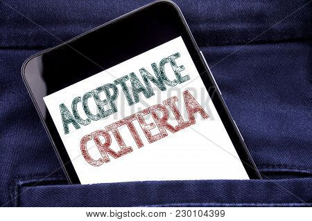 Handwriting Announcement text showing Acceptance Criteria. Business concept for Digital Criterion Written phone mobile phone, cellphone placed in man front jeans pocket. poster