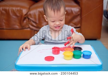 Cute Smiling Little Asian 18 Months / 1 Year Old Toddler Baby Boy Child Finger Painting With Hands A