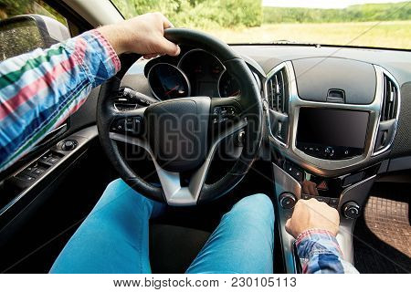 Close Up Of Steering Wheel In Male Driver Hand, Copy Space. Man's Hand Holding Steering Wheel Inside