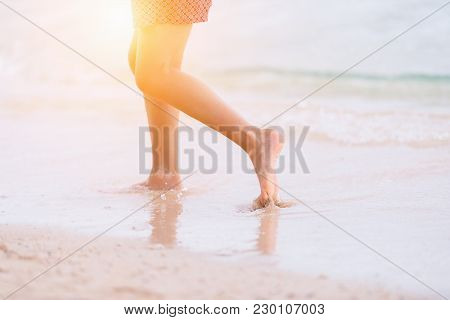 Young Asian Woman Walking On Sand Beach,relaxing And Holiday Concept.