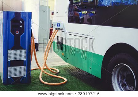 Details Of Electric Vehicle Charging City Bus Transport. Green And Renewable Energy Sources