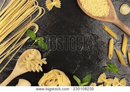 An Overhead Photo Of Different Types Of Pasta, Including Spaghetti, Orzo, Fusilli, Penne, With Fresh