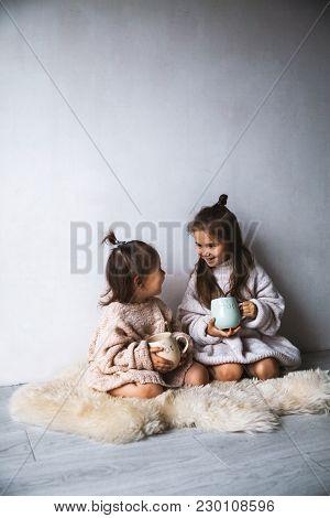 Cute Little Girls Drinks Tea In The Morning A