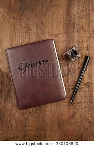 Leather Bound Journal Titled Grimoire, And Ink Well And Pen