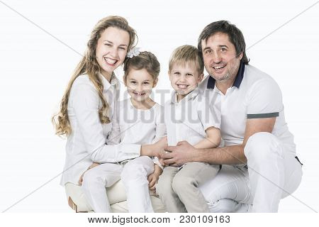 Family Photo.happy Family.parents And Children.the Photo Has A Blank Space For Text