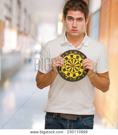 Young Man Holding Dartboard, indoor