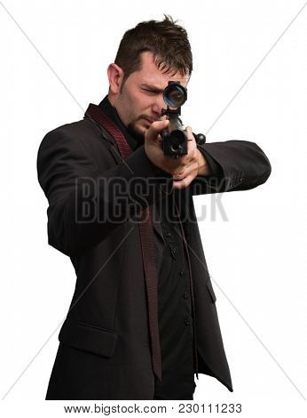 Man aiming with rifle against a white background