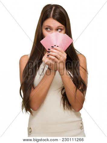 Pretty Young Woman Holding Playing Cards On White Background
