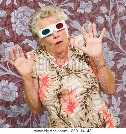 Afraid Senior Woman Watching 3d Movie On Wallpaper