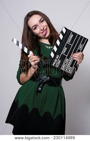Showing The Language Young Woman Holding A Movie Clapper