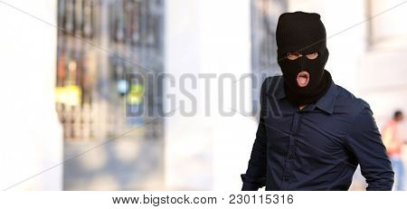 Burglar in face mask, outdoor