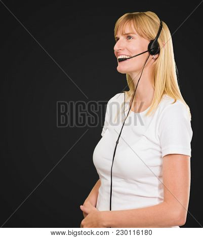 Happy Woman On Headset against a black background