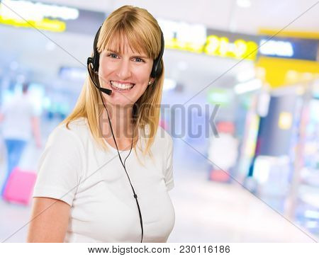 Happy Woman On Headset at the airport