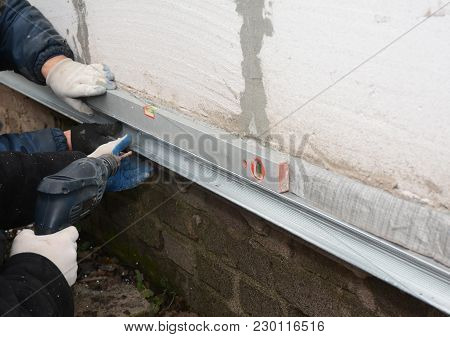 Old House Foundation Wall Repair And Renovation  With Installing Metal Sheets For Waterproofing And
