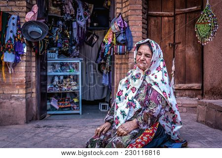 Abyaneh, Iran - October 19, 2016: Iranian Woman Sells Souvenirs And Craft Products In Abyaneh Villag