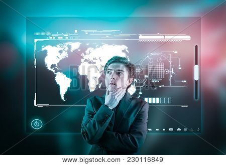 Thoughtful Businessman In Front Of High Tech Screen On An Abstract Background.