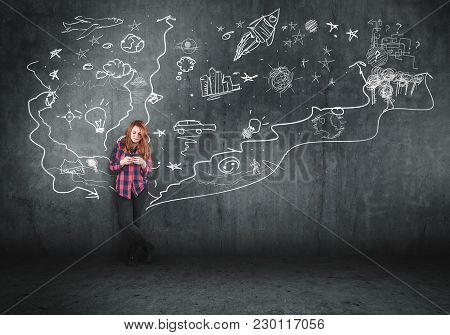 Woman Using Smartphone Next To A Painted Wall. The Concept Of Telling A Story.