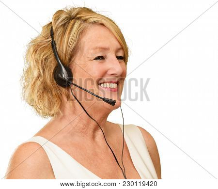 Portrait Of A Mature Woman Wearing Headset On White Background