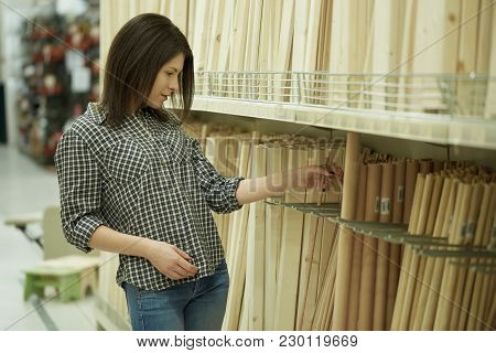 Young Beautiful Woman Working At Hardware Store