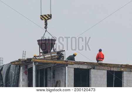 Construction Works - Workers On A House Construction