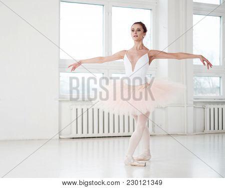 Gracefull ballerina in a dance studio.